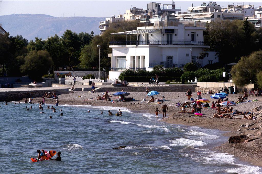 Photo taken on Sept. 1, 2020 shows bathers at a beach in Faliro suburban Athens, Greece, on Sept. 1, 2020.
