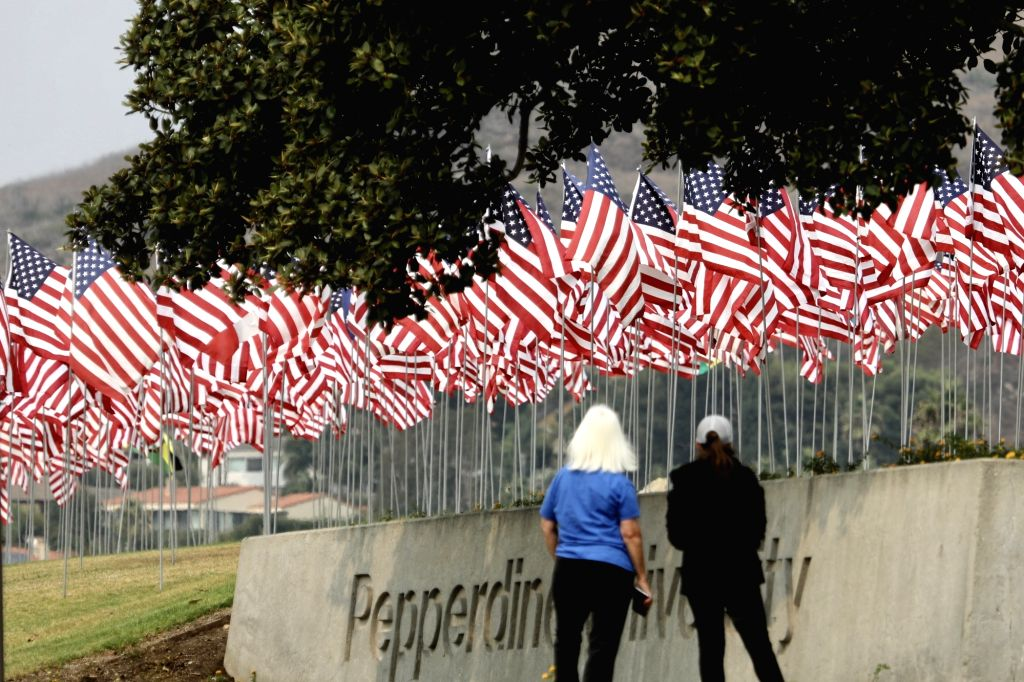 Photo taken on Sept. 11, 2020 shows the Waves of Flags display at Pepperdine University in Malibu, the United States, to honor the victims of the 9/11 attacks. ...