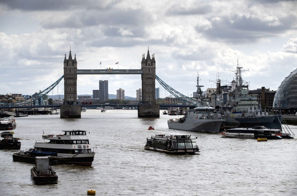 Photo taken on Sept. 12, 2020 shows vessels on the River Thames backdropped by the Tower Bridge, in London, Britain. Britain's gross domestic product (GDP) recorded ...