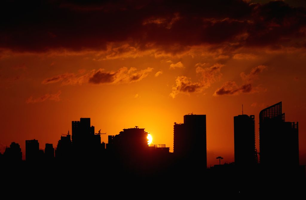 Photo taken on Sept. 13, 2020 shows the city view in sunset glow in Beirut, Lebanon.