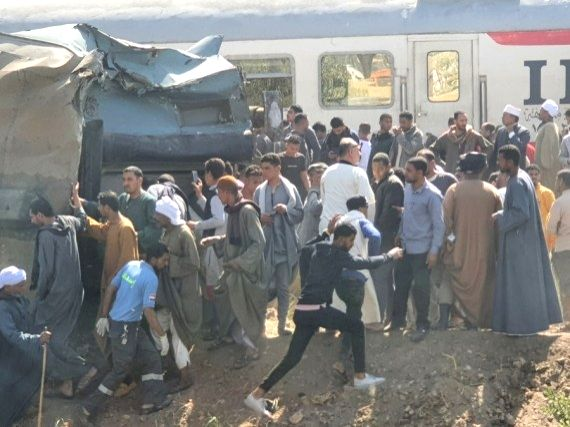 Photo taken with a mobile phone on March 26, 2021 shows people gathering at the site of a train collision in Sohag, Egypt, March 26, 2021.