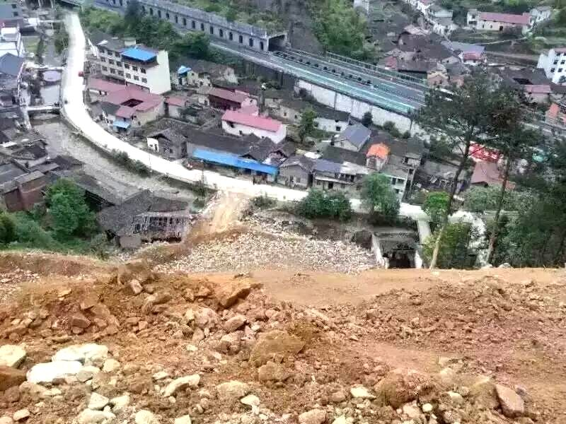 Photo taken with a mobile phone shows the accident site after a landslide hit Lidong Village of Yaxi Township in the outlying Liandu District of Lishui City, east ...