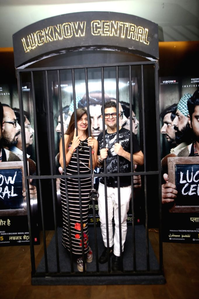 """Photographer Dabboo Ratnani along with his wife Manisha D Ratnani during the special screening of upcoming film """"Lucknow Central"""" in Mumbai on Sept 10, 2017"""