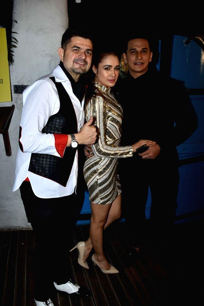Photographer Dabboo Ratnani with actor Prince Narula with his wife Yuvika Chaudhary at the launch of his calendar in Mumbai, on Jan 28, 2019. - Prince Narula and Yuvika Chaudhary