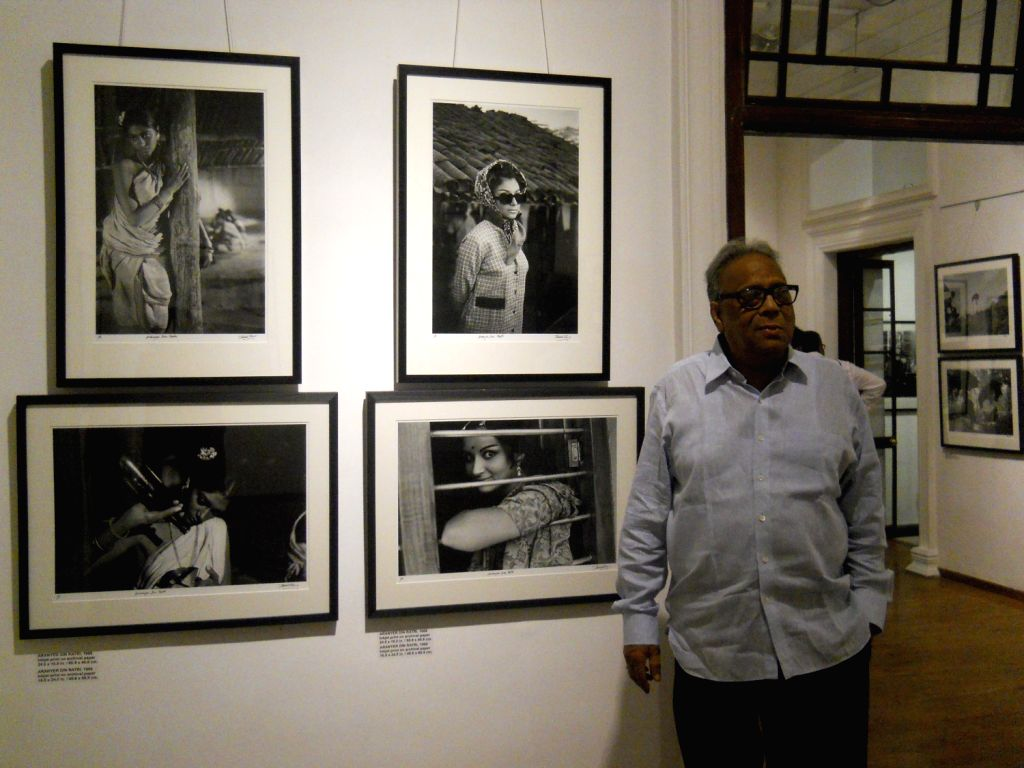 "Photographer Nemai Ghosh exhibiting his work ""Satyajit Ray and Beyond"" presented by the Delhi Art Gallery in Kolkata on August 16, 2013. Nemai Ghosh is best known as Satyajit Ray's ..."