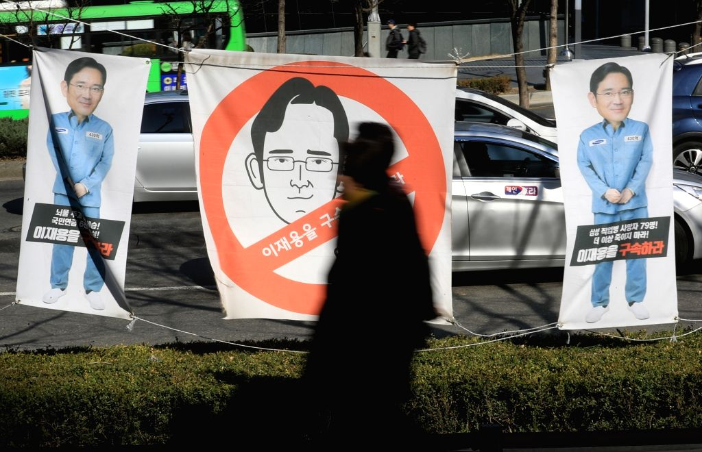 Photos of Lee Jae-yong, vice chairman of Samsung Electronics and heir apparent of Samsung Group, are displayed in front of the company headquarters in Seoul on March 9, 2017, depicting him in ...