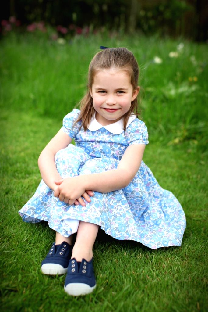 Photos of Princess Charlotte shared by the Duke and Duchess of Cambridge. The photographs were taken in April by The Duchess at Kensington Palace and at their home in Norfolk.