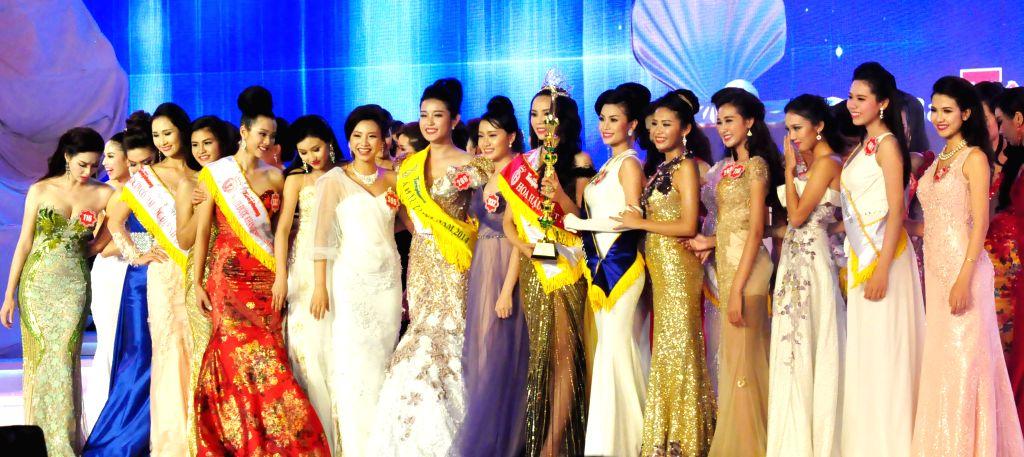 Phu Quoc: Contestants pose for photos during the Miss Vietnam 2014 finals in Phu Quoc, Vietnam, Dec. 6, 2014.