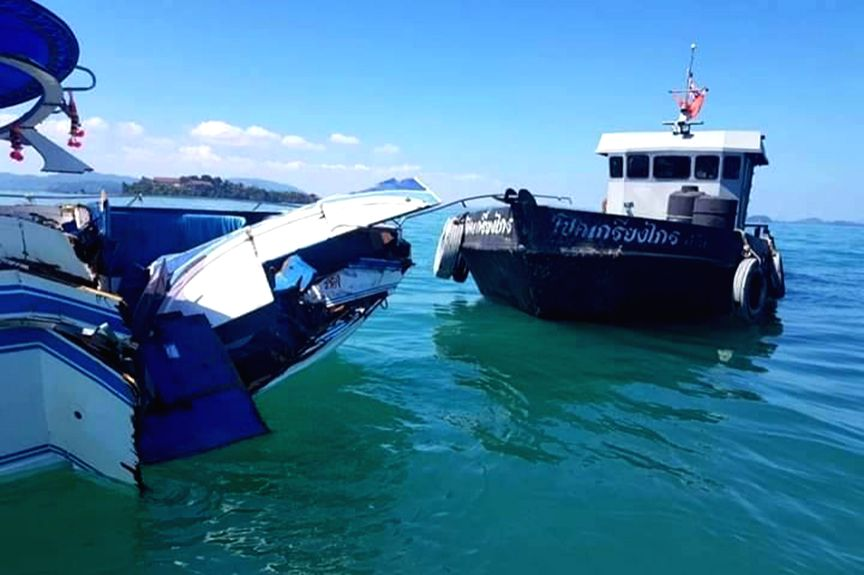 PHUKET, Feb. 10, 2019 - Photo taken on Feb. 9, 2019 shows the damaged speedboat (L) at sea area near the Phuket Island, Thailand. A total of 11 Chinese tourists and two crew members were injured ...