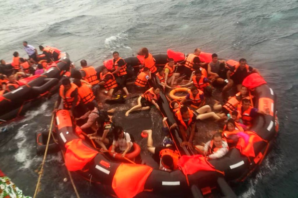 PHUKET, July 6, 2018 - Rescued tourists are seen on life rafts near the island of Phuket, Thailand, July 5, 2018. Until 8:30 p.m. local time (1330 GMT) Thursday, the majority of 133 passengers on two ...