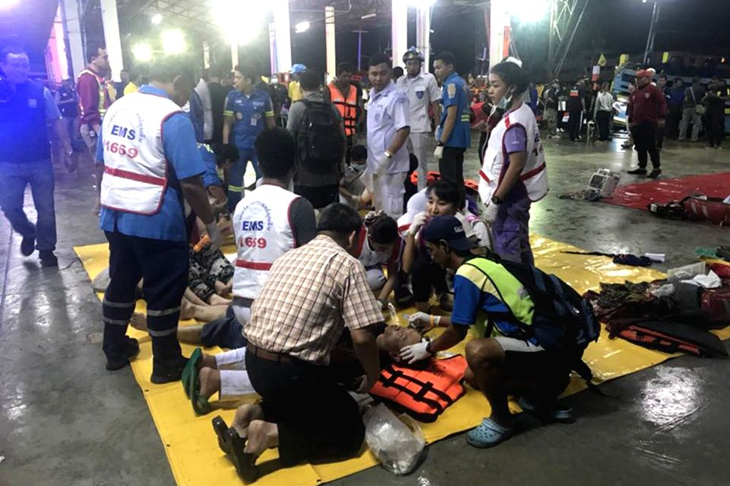 PHUKET, July 6, 2018 - Rescued tourists receive medical treatment on the island of Phuket, Thailand, July 5, 2018. Until 8:30 p.m. local time (1330 GMT) Thursday, the majority of 133 passengers on ...
