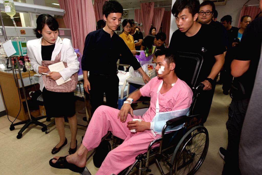 PHUKET, July 7, 2018 - An injured Chinese tourist receives medical treatment at a hospital in Phuket, Thailand, July 7, 2018. Chinese officials on Saturday visited the Chinese tourists who were ...
