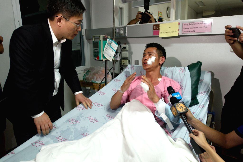 PHUKET, July 8, 2018 - Injured Chinese tourist Huang Junxiong talks with Chinese Ambassador to Thailand Lyu Jian at a hospital on Phuket island, Thailand, July 7, 2018. At least 42 people were ...