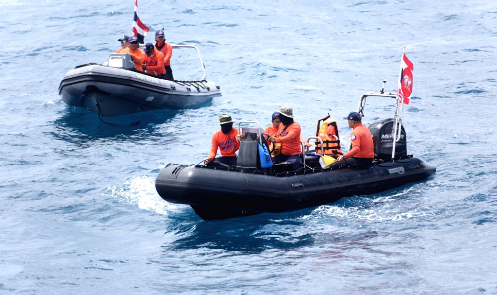 PHUKET, July 8, 2018 - Members of Thai rescue team search for missing passengers from the capsized boat in the accident area in Phuket, Thailand, July 8, 2018. At least 42 people were confirmed dead ...