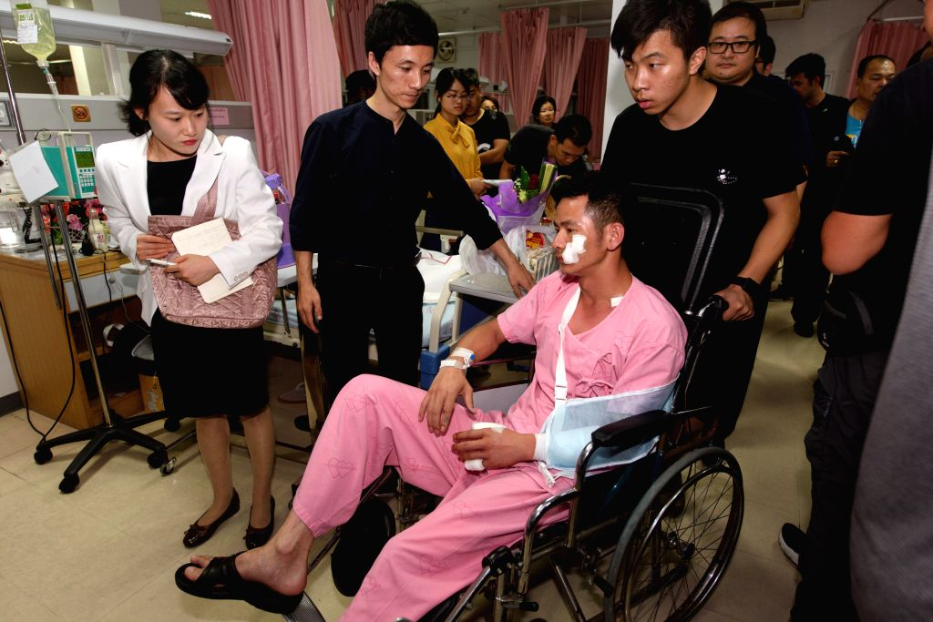 PHUKET, July 8, 2018 - Survived tourist Huang Junxiong is carried back to his bed-ward on wheelchair at a hospital on Phuket island, Thailand, July 7, 2018. At least 42 people were confirmed dead and ...