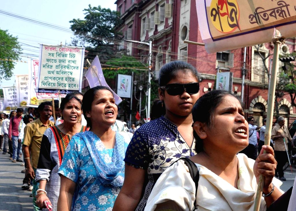Physically challenged people participates in a rally to protest against the West Bengal government in Kolkata on March 6, 2017.