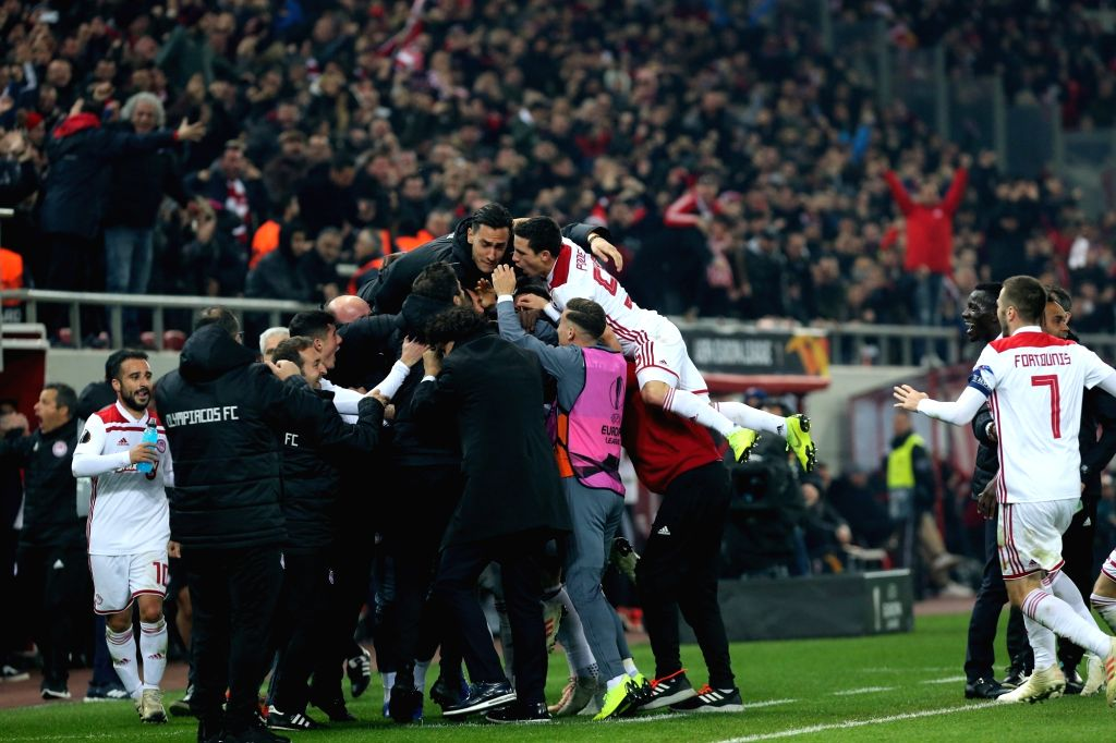 PIRAEUS, Dec. 14, 2018 - Olympiacos' players celebrate during the the UEFA Europa League Group F match between Olympiacos and AC Milan in Piraeus, Greece, Dec. 13, 2018. Olympiacos won 3-1.