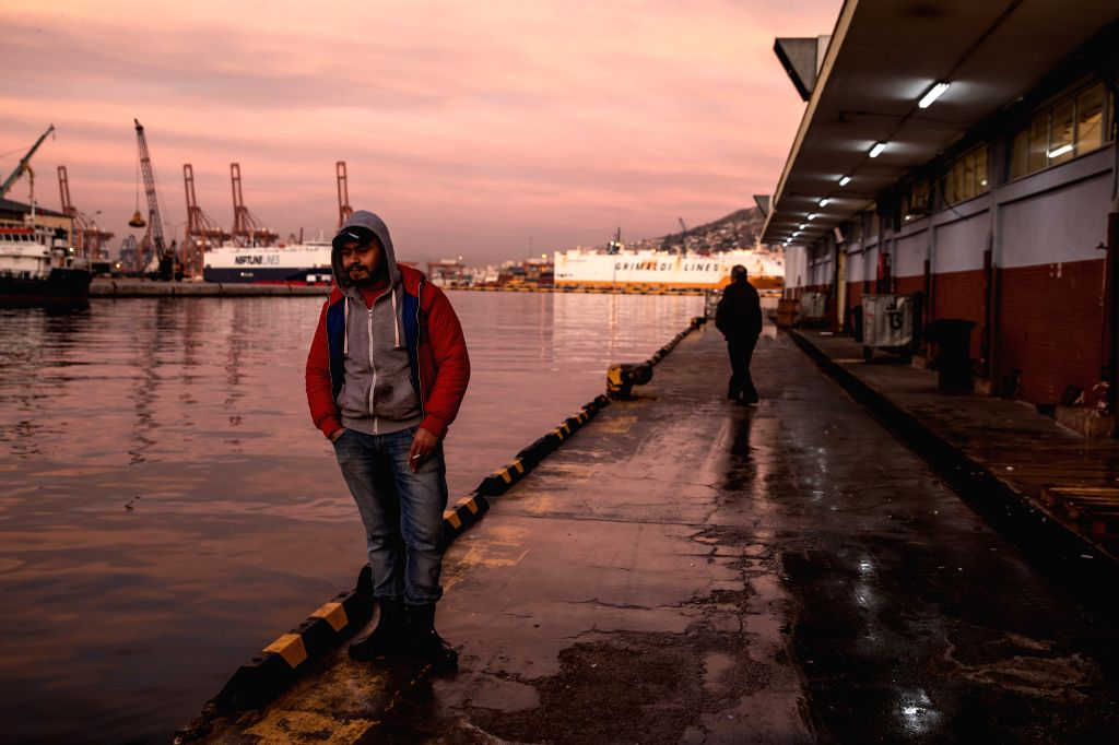 PIRAEUS, Feb. 3, 2019 - A worker of the fish market in Keratsini is seen as the sun slowly rises in Piraeus, Greece, on Feb. 2, 2019. The fish market in Keratsini operates from 1965 with fishermen ...