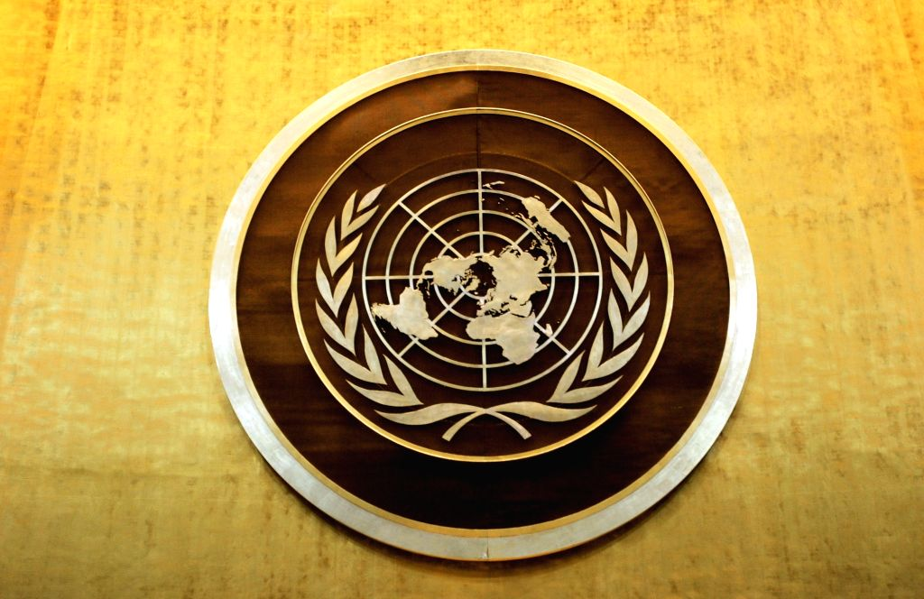 Plaque bearing the United Nations logo above the podium of the General Assembly Hall. (File Photo: Ryan Brown/UN Photo/IANS)