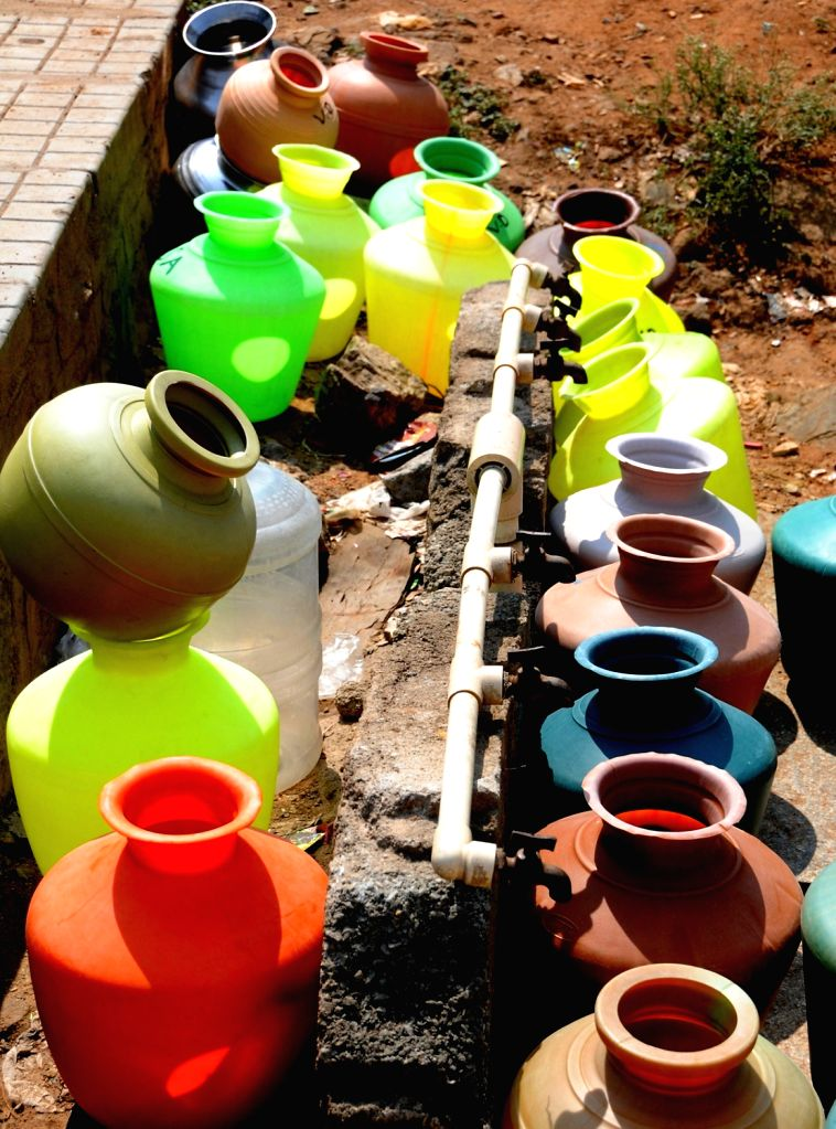 Plastic water pots placed under roadside taps, in Bengaluru on March 22, 2018. March 22 is observed as World Water Day.