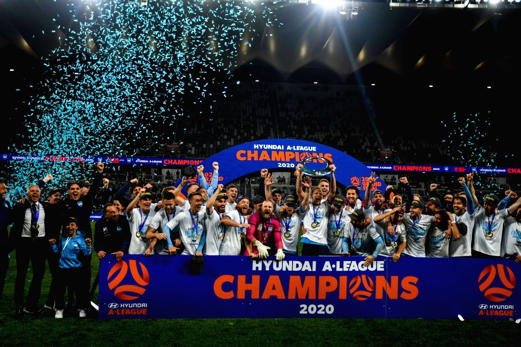 Players and staff members of Sydney FC celebrate during the awarding ceremony for the 2019/2020 season A-League in Sydney, Australia, Aug. 30, 2020. Sydney FC ...