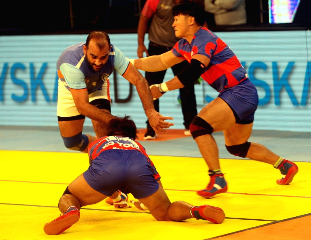 Players in action during a 2016 Kabaddi World Cup match between India and Korea in Ahmedabad on Oct 7, 2016. Korea won. Score: 32- 34.