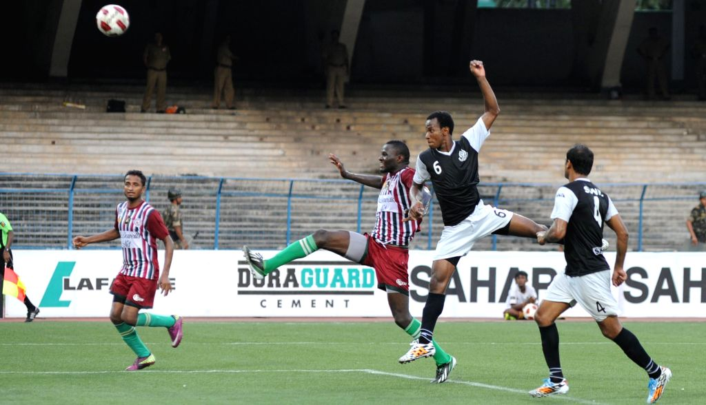 Players in action during a Calcutta Football League match between Mohun Bagan A.C. and Mohammedan S.C. in Kolkata on Aug 24, 2014. Mohammedan S.C. won the match. Score: 2-1.