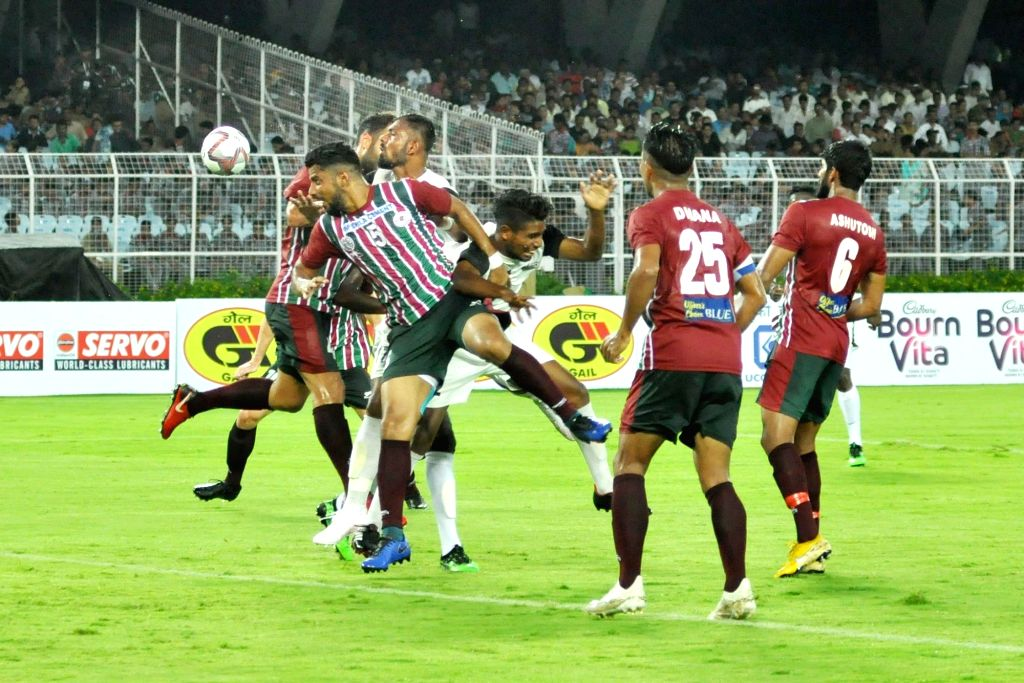 Players in action during a Durand Cup match between Mohun Bagan and Mohammedan Sporting Club at Salt Lake Stadium in Kolkata on Aug 2, 2019.