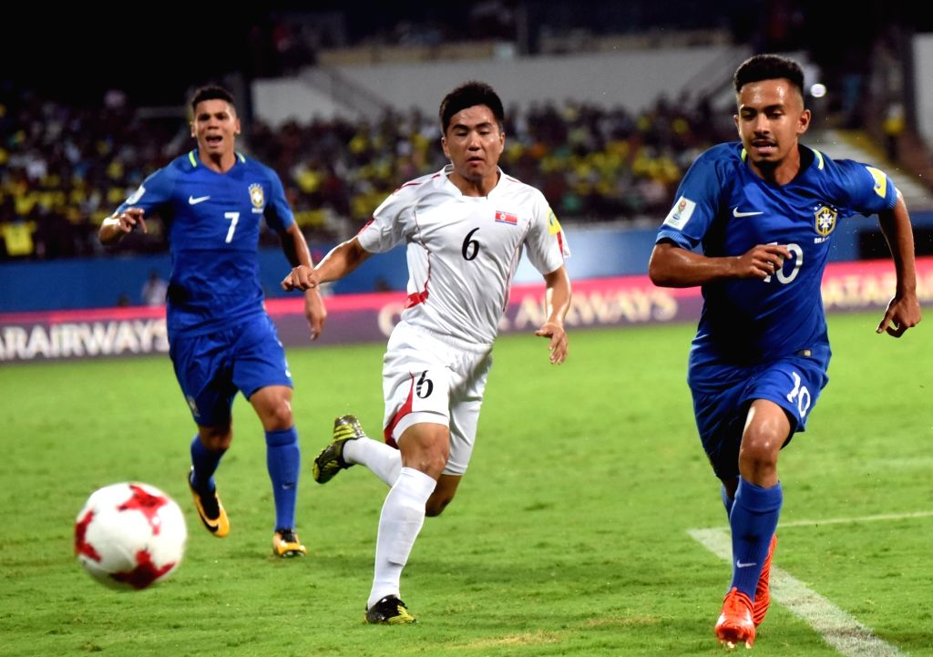 Players  in action during a FIFA U-17 World Cup Group D match between Korea DRP and Brazil in Kochi, Kerala on Oct 10, 2017.