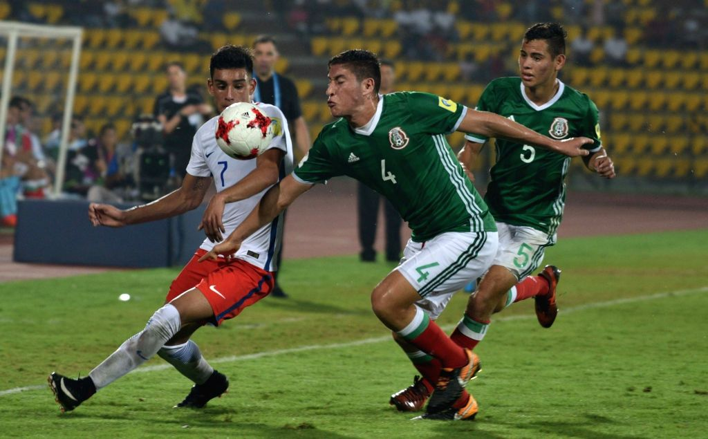 Players in action during a FIFA U-17 World Cup Group F match between Mexico and Chile in Guwahati on Oct 14, 2017.