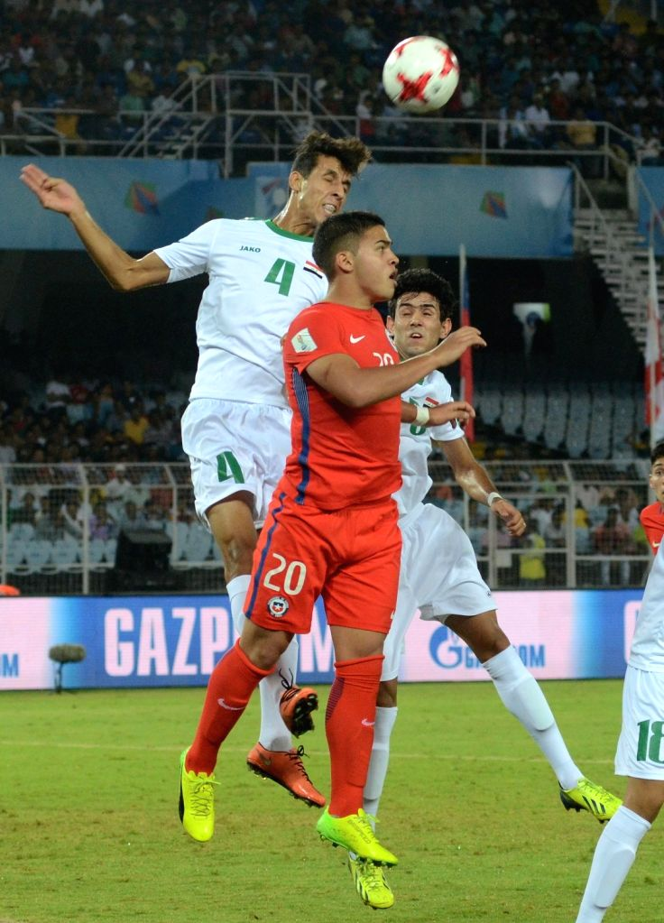 Players in action during ​a FIFA U17 World Cup India 2017 Group F match between Iraq and Chile at Salt Lake Stadium in Kolkata on Oct 11, 2017.