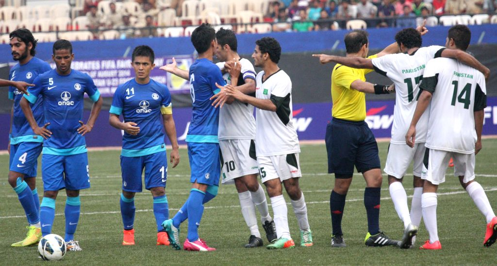 Players in action during a friendly football match between India and Pakistan at Bangalore Football Stadium on Aug 20, 2014.