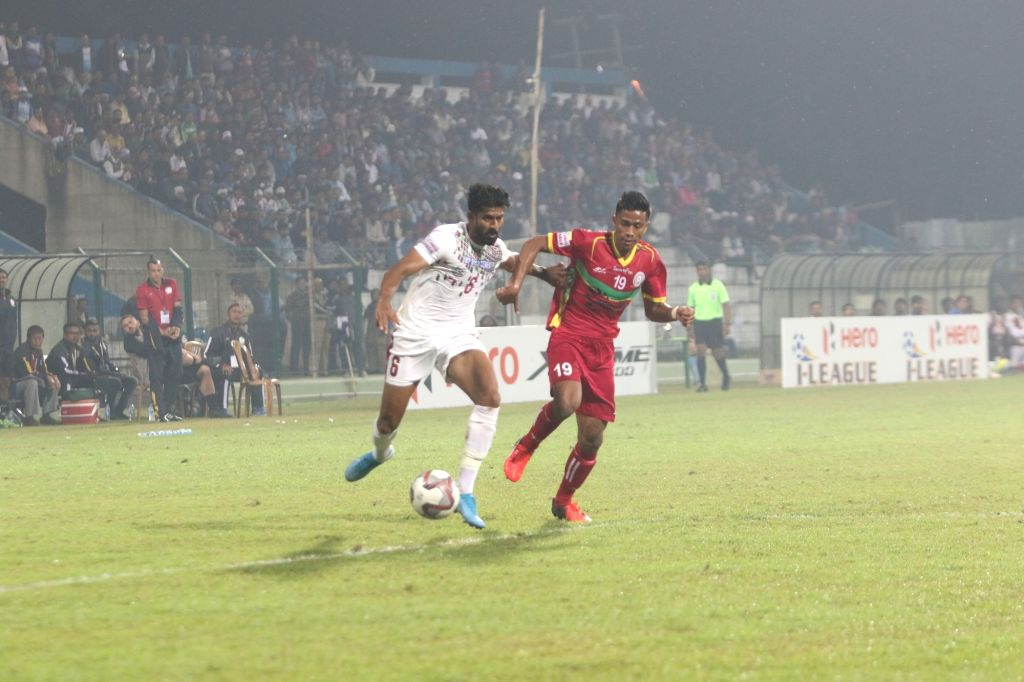Players in action during a Hero I-League match between Mohun Bagan and league debutants Tiddim Road Athletic Union (TRAU) FC at the Kalyani Municipality Stadium in West Bengal's Kalyani on ...
