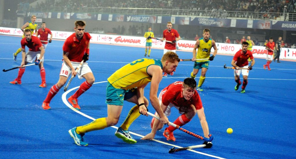 Players in action during a Hockey World League Final match between Australia and England at Kalinga Stadium in Bhubaneswar on Dec 4, 2017.