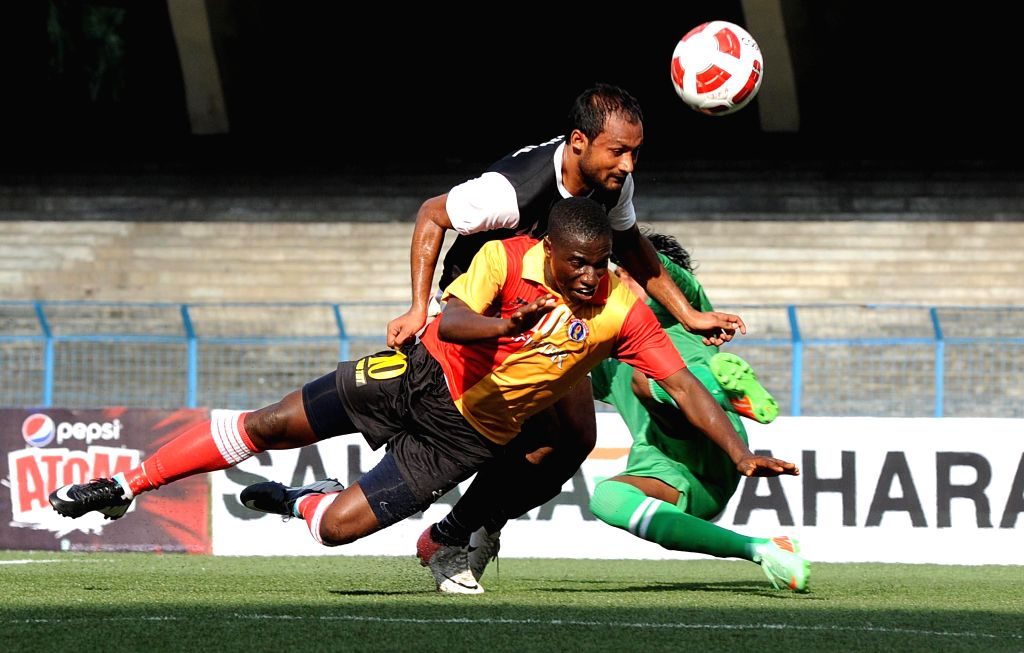 Players in action during a Kolkata League match between East Bengal and Mohammedan Sporting club in Kolkata on Aug 10, 2014. East Bengal won the match. (Score: 1-0).