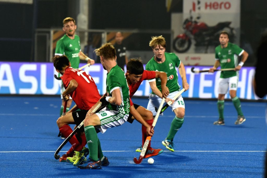 Players in action during a Men's Hockey World Cup 2018 between Ireland and China at Kalinga Stadium in Bhubaneswar on Dec 4, 2018.