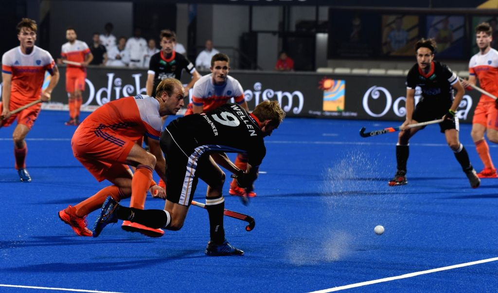 Players in action during a Men's Hockey World Cup 2018 between Germany and Netherlands at Kalinga Stadium in Bhubaneswar on Dec 5, 2018.