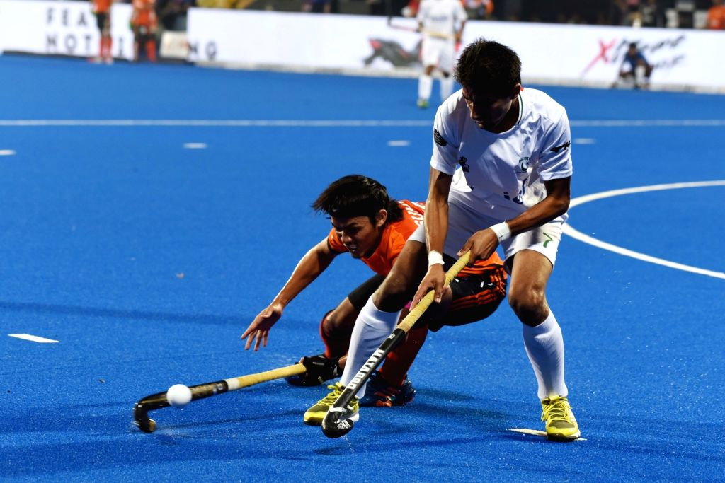 Players in action during a Men's Hockey World Cup 2018 between Pakistan and Malaysia at Kalinga Stadium in Bhubaneswar on Dec 5, 2018.