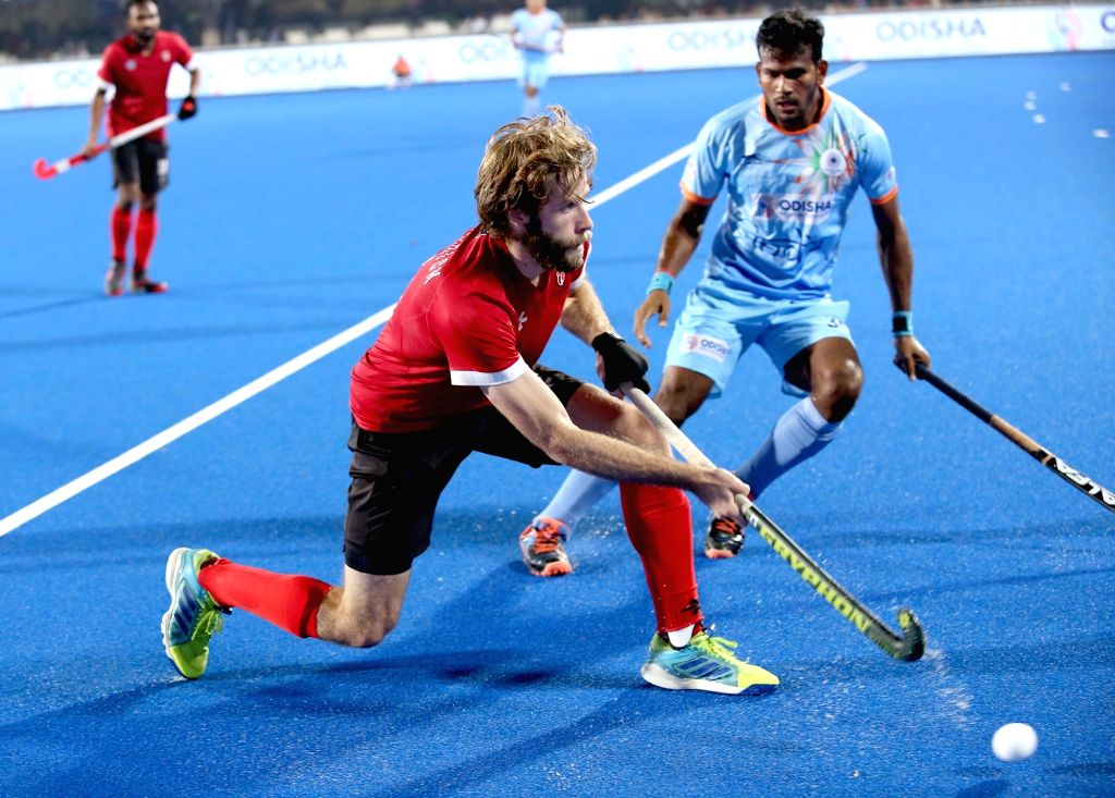 Players in action during a Men's Hockey World Cup 2018 between India and Canada at Kalinga Stadium in Bhubaneswar on Dec 8, 2018.