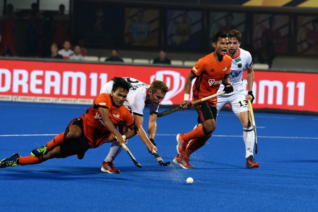 Players in action during a Men's Hockey World Cup 2018 match between Germany and Malaysia at Kalinga Stadium in Bhubaneswar on Dec 9, 2018.