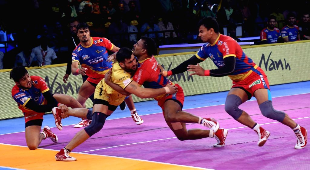 Players in action during a Pro Kabaddi 2018 match between Telugu Titans and UP Yoddha at Rajiv Gandhi Indoor Stadium in Visakhapatnam on Dec 11, 2018.