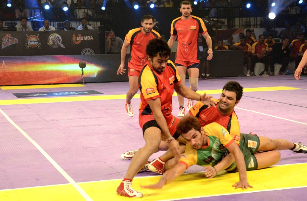 Players in action during a Pro Kabaddi League match between Patna Pirates and Bengaluru Bulls at Patliputra Indoor Stadium in Patna on Aug 10, 2014. Bengaluru Bulls won. Score: 37 - 35.