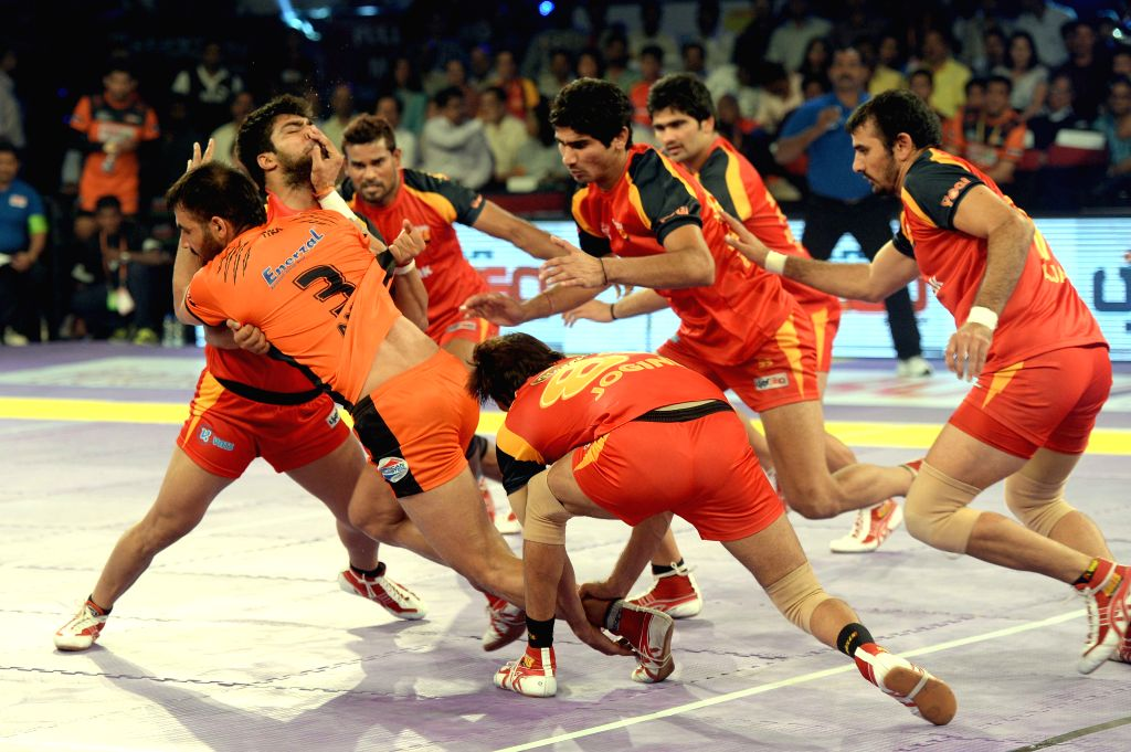 Players in action during a Pro Kabaddi league match between U Mumba and Bengaluru Bulls at Thyagraj Stadium in Bengaluru, on Aug 12, 2015.