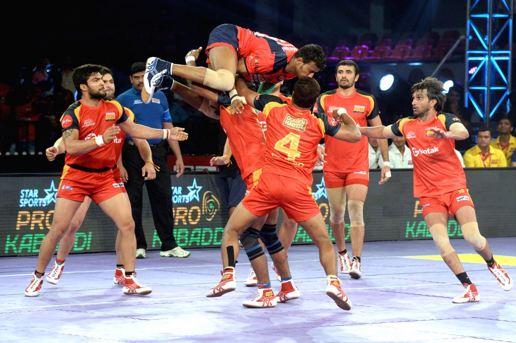 Players in action during a Pro Kabaddi league match between Bengaluru Bulls and Dabang Delhi at Kanteerava Stadium in Bengaluru, on Aug 14, 2015.