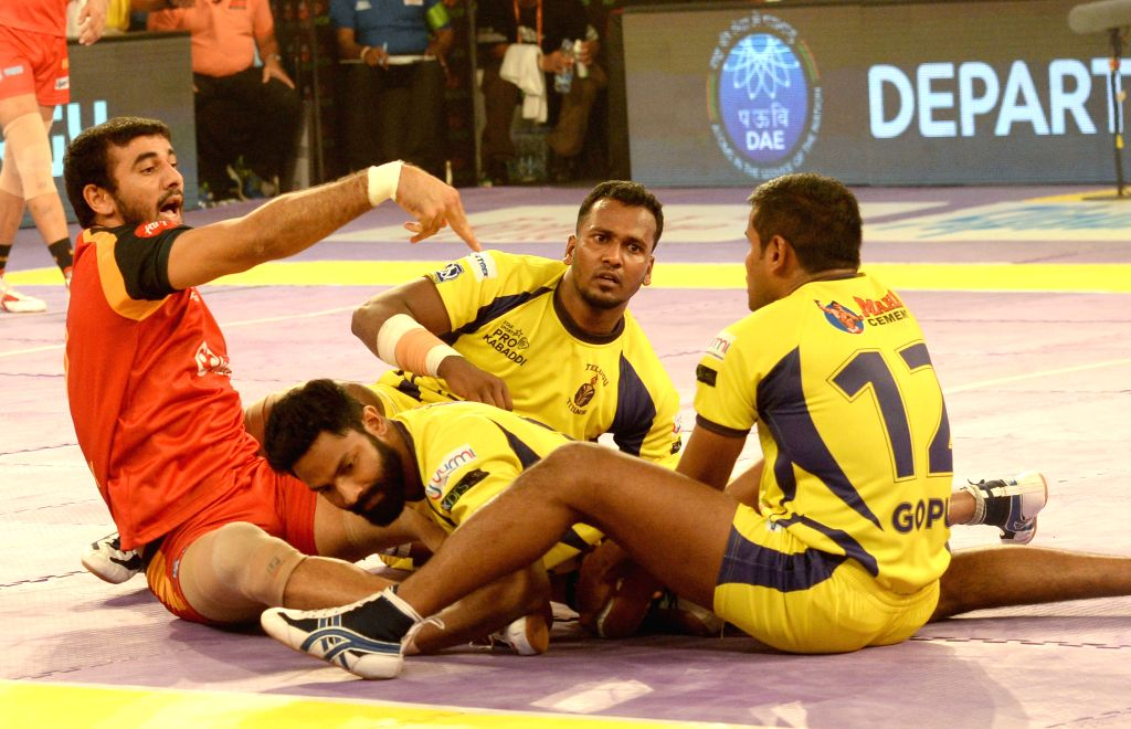 Players in action during a Pro Kabaddi league match between Bengaluru Bulls and Telugu Titans at Kanteerava Stadium in Bengaluru, on Aug 15, 2015.