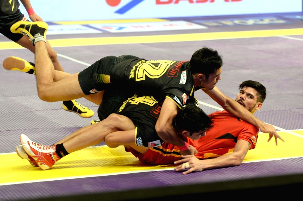 Players in action during a Pro Kabaddi League 2016 match between Bengaluru Bulls and Telagu Titans in Bengaluru, on July 12, 2016.