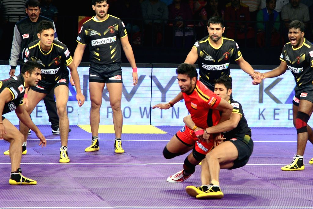 Players in action during a Pro Kabaddi League 2016 match between Bengaluru Bulls and Telugu Titans in Bengaluru, on July 12, 2016.