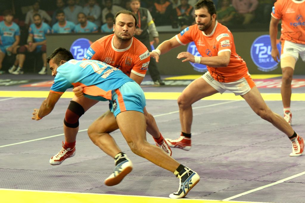 Players in action during a Pro Kabaddi League 2016 match between Puneri Paltan and Bengal Warriors in Bengaluru, on July 12, 2016.