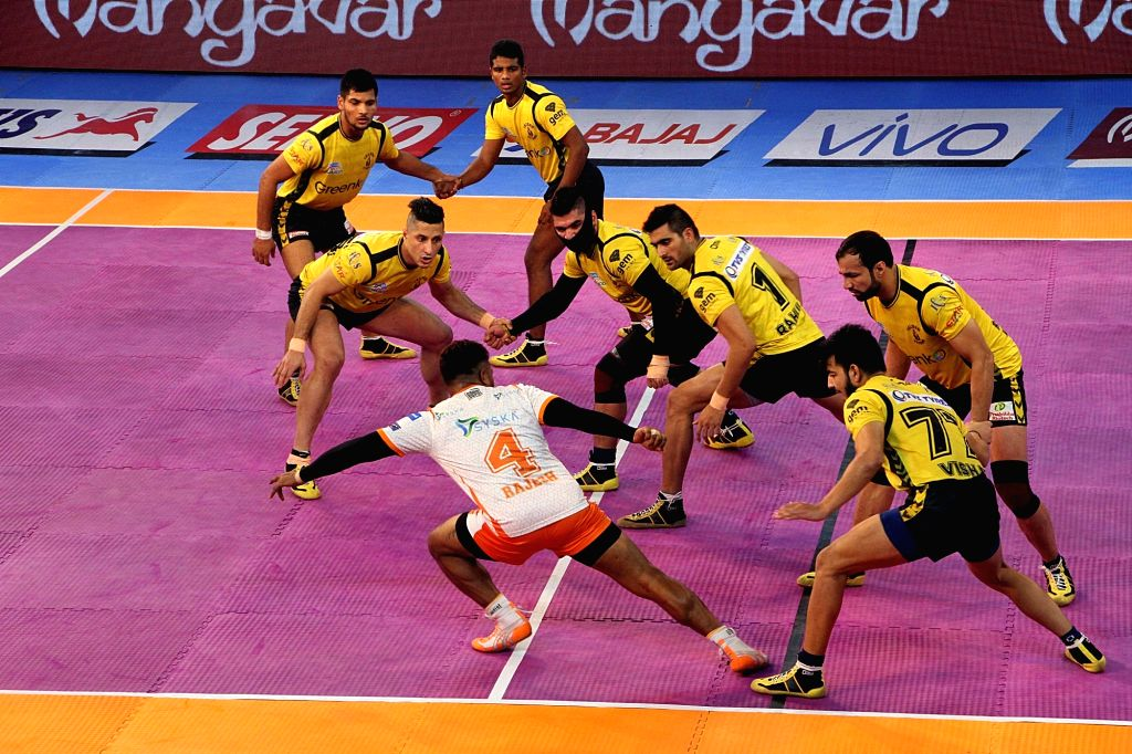 Players in action during a Pro Kabaddi League 2017 match between Telugu Titans and Puneri Paltan in Kolkata on Sept 7, 2017.