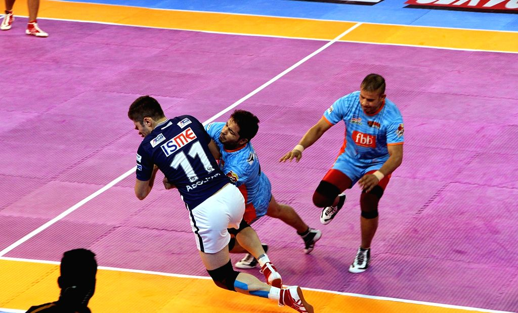 Players in action during a Pro Kabaddi League 2017 match between Dabang Delhi and Bengal Warriors in Kolkata on Sept 7, 2017.